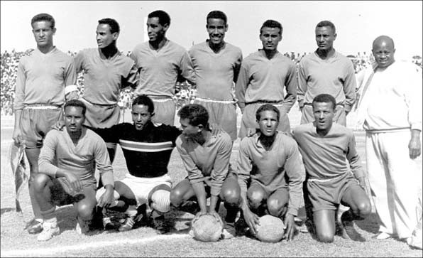 The Ethiopian National Team that won the 3rd African Cup (1962). (L- R standing): Luciano Vassalo (captain), Awad Mohammed, Tesfaye GebreMedhin, Berhe Goytom, Asmelash Berhe, Kiflom Araya, Gashe Tilahun (trainer);  (L- R sitting): Girma Zeleke, Gila-Michael T. Mariam, Italo Vassalo, Getachew Wolde, Mengistu Worku.