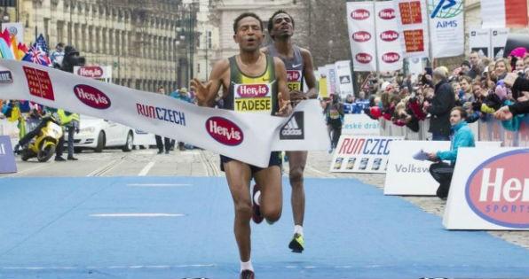 Eritrean pride Zersenay Tadese and Amanuel Mesel crossing the finishing line at the Hervis Prague Half Marathon