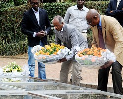 Foreign Minister Osman Saleh, (C) and RPF Commissioner Joseph Karemera lay wreathes at the Kigali Genocide Memorial Centre (August 4th)