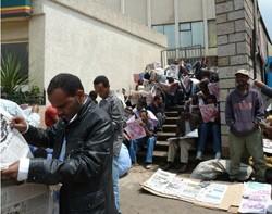 A youth who can not afford to buy a newspaper rent a read from 'newspaper landlords' only in Ethiopia