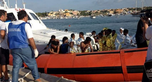 The Italian coastguard brings survivors of Thursday's tragedy to the harbour in Lampedusa