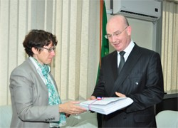Ambassador of France to the AU, Brigitte Collet, handing over copies of 45 African border Agreements