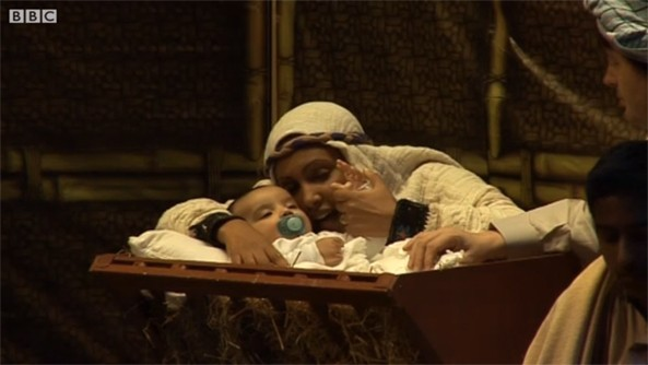Multicultural Nativity Play with performers from 56 countries. The baby Jesus is from Eritrea