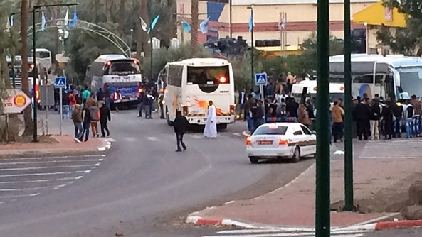 After a bus full of hooligans arrive for the specific purpose disrupting and attacking the Eritrean community members in Israel, the brawl spills into the street.