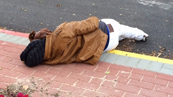 One of the dozens of wounded Eritrean lies on the street