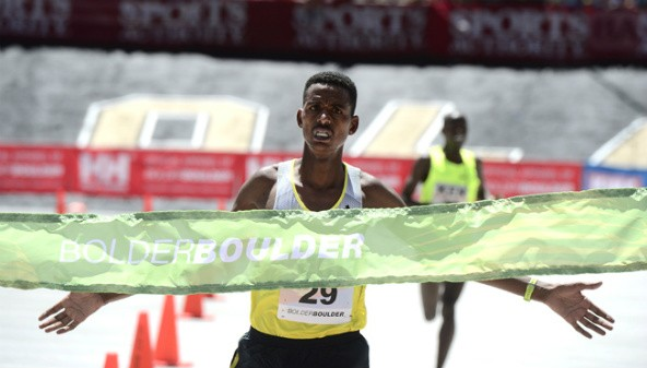 Men's elite race winner Eritrean Afewerki Berhane crosses the finish line. Despite its first year participation, Eritrea become the winner of both the team and individual challenge at the 2014 Bolder Boulder Men's International race