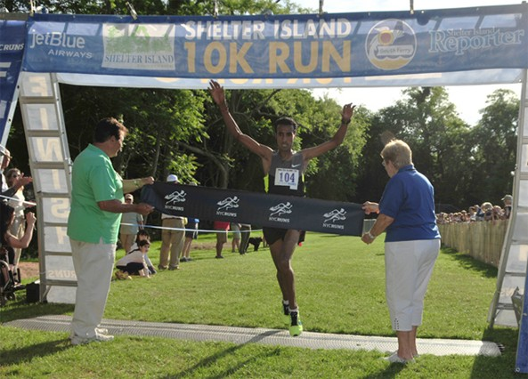 Yonas Mebrahtu crosses the finish line first at the 35th annual Shelter Island 10K Saturday