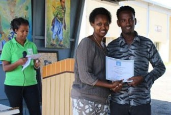 UN Resident Coordinator, Christine N. Umutoni, and Winner of Student Poetry Competition