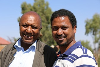 Dawit Kebede, editor of Awramba Times, with his boss, Bereket Simon, the notorious jailer of Ethiopian journalists