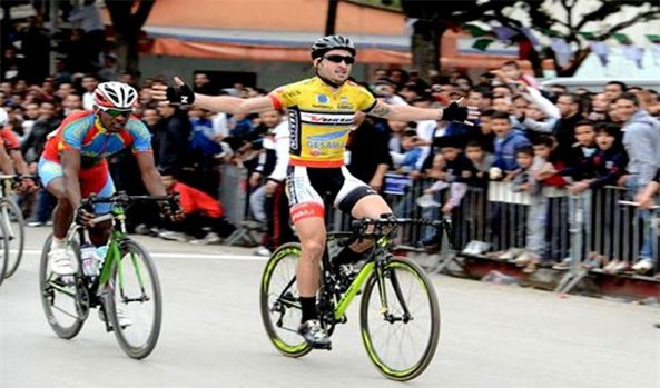 Algerian Abdelbaset Hannachi snatching the final victory from Eritrean Mekseb Debesay  at the Grand Tour of Algeria