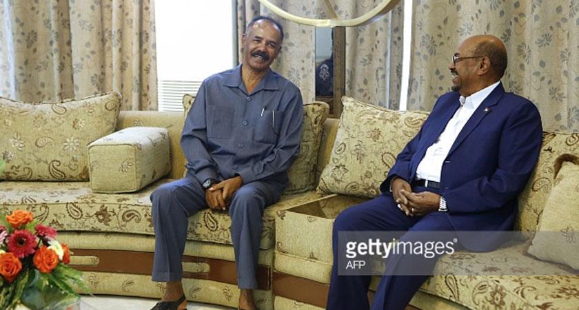 Sudanese President Omar al-Bashir sits with Eritrean President Isaias Afwerki