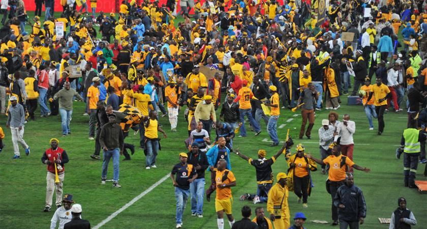 Zebra fans invading the pitch