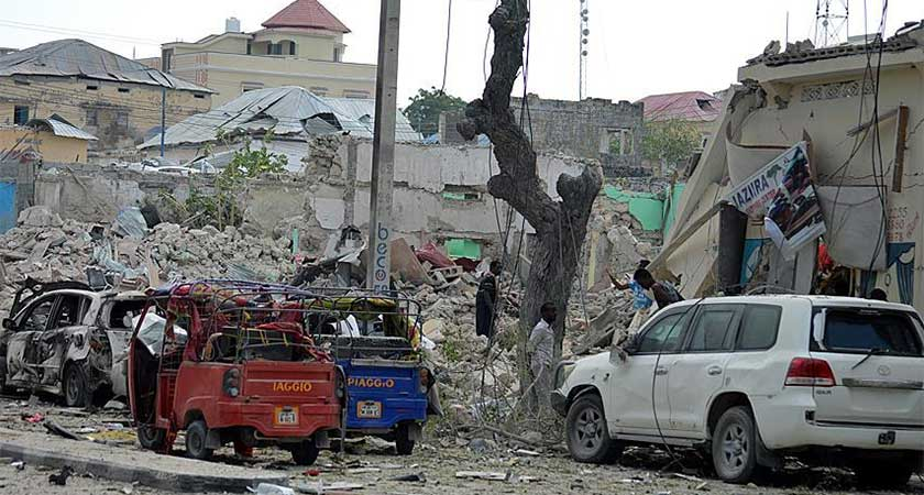 Massive car bomb kills at least 20 people in a busy market in Mogadishu