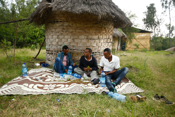 Men chewing khat near the bank of the Nile River in Bahir Dar