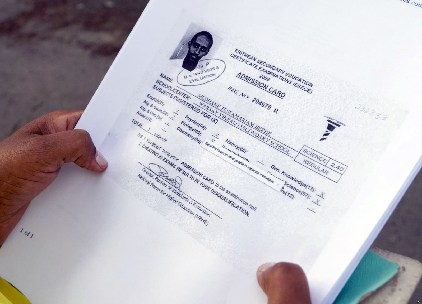 Hiwet Tesfamariam Berhe holds photocopies of school documents