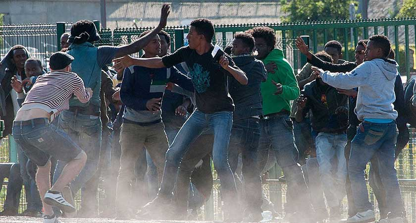 Five Migrants Shot in Huge Calais Brawl Between Afghan and Eritrean Gangs