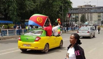 Ethiopians waving the Eritrean flag in the middle of Addis Ababa.
