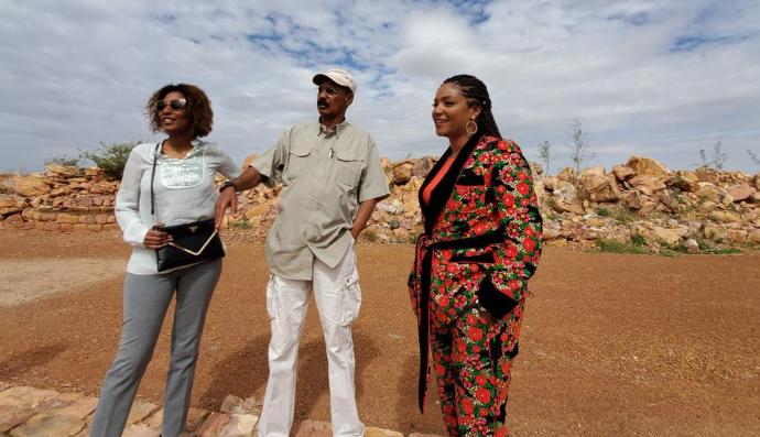 Tiffany Haddish and President Isaias observing the newly built dam at Adi Logo